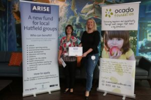onslow-st-audreys-schools-lisa-charalambous-is-presented-with-a-cheque-from-arise-hatfield-by-ocado-head-of-corporate-affairs-suzanne-westlake-picture-danny-loo